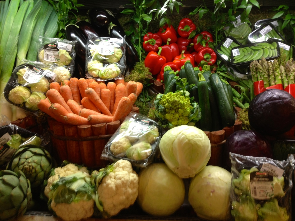 Gorgeous produce displayed like precious gems.