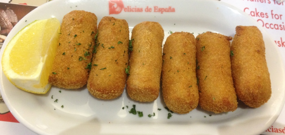 Croquettas deBacalao. This is the place where I learned to love these. They are essentially potato and bechamel sauce whipped together with salt cod. This is then rolled into little finger shaped/sized croquettas, breaded, refrigerated and fried until golden. These are the best in Miami, period.